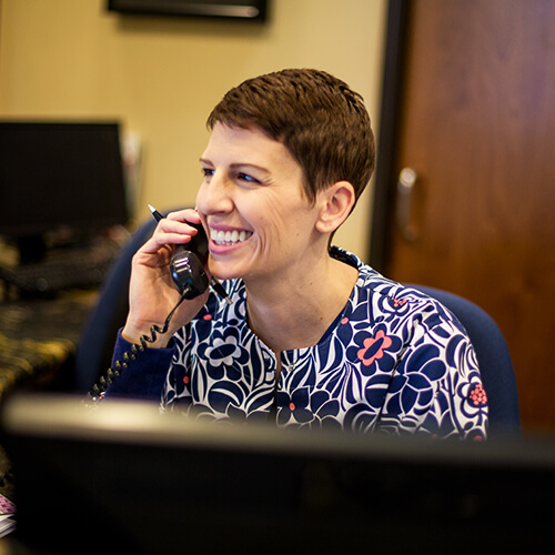 Our front-desk team member speaking on the phone to a patient in Chandler AZ