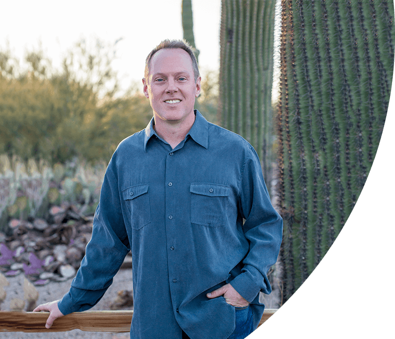 Dr. Robert F Walker Jr. , your dentist in Chandler, AZ standing in front of a cactus and smiling